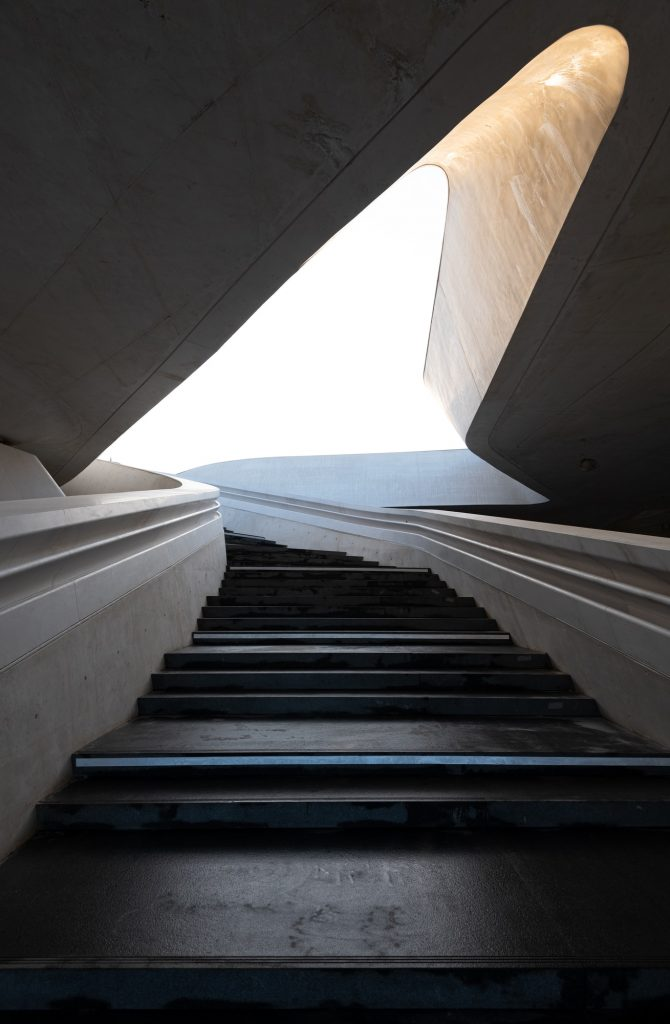 modern-architecture-and-empty-staircase-leading-to-a-bright-open-space.jpg